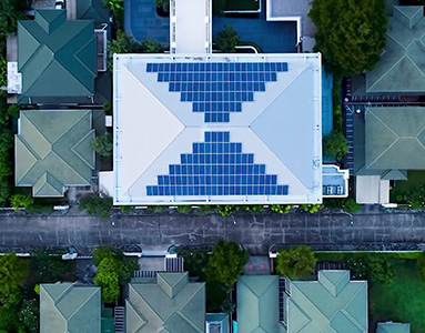 A bird's eye view of a rooftop covered in solar-powered tiles.